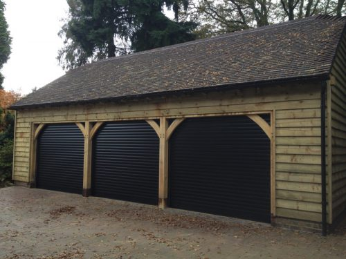 Three Elite roller garage doors in black