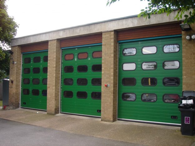 Green Sectional Door With Multiple Windows