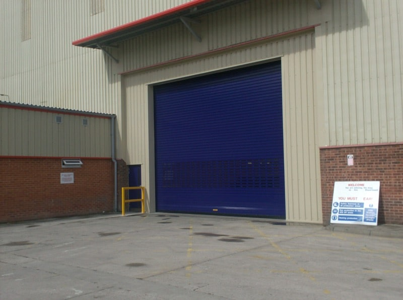 Single blue security shutter on a commercial property.